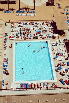 I have a serious crush on any aerial view of beaches and pools! They're so abstract and unexpected pieces of art. I want one blown up to a decent size hanging over my bed! Then, I could make up stories about the people in the picture. -AP