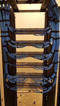 Cat 6 Ethernet cables terminated NEATLY into patch panels. The importance of clean, well-organized cabling is crucial to maintaining everything properly and allow for easy expansion. Data Center Rack, Data Center Design, Network Rack, Network Organization, Data Room, Structured Cabling, Network Infrastructure, Server Room, Network Cable