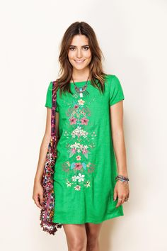 Fresh bohemian outfit. Gorgeous green dress with embroidered detail, hippie cross body & layered wrist wear.