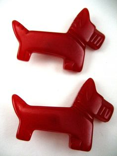 Scottie dog buttons in red bakelite - we want to know if anybody made doxie buttons - we're the cutest!