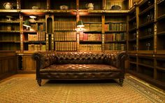 A big leather couch, in a library. Free Library, World Religions, Laguna Beach, Bookshelves, Man Cave, Household, Couch, Living Room, Places