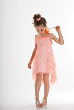Your young fashionista will glow all season long in this zippy zebra print knit sundress in a gorgeous shade of coral. A trendy hi low hemline, double shoulder straps and scattered sequin embellishments add to the fun. - Stunning coral and white chiffon dress in a fun zebra print has a high-low hemline - This dress has double shoulder straps and a ruffle at neckline - Bodice ruffle is scattered with sequins - Care Instructions: Machine Wash - Made with Shell 100% Polyester. Lining 58%…
