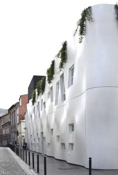 Purafacades | Cräche rue Pierre Budin by ECDM, Paris, France, The building is in prefabricated concrete, long-lasting and resistant to the torments of the urban life. The surrounding wall is drilled by translucent and colored windows.