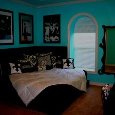 tiffany blue bedroom with our black bed and white down comforter yes please