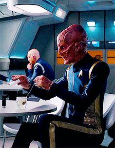 Lieutenant Saru adding salt to his tea