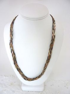 5 Chain Braided Necklace Gold Tone, Silver Tone and Copper Tone 22 inches. $39.95, via Etsy.