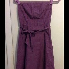 """American Eagle Outfitters Sz 2 Very cute strapless 100% cotton strapless dress size 2. Purple plaid with belt. Measurements: bust across the front 13"""", waist across the front 13"""", length from top to hem 34"""". Excellent condition. American Eagle Outfitters Dresses Strapless"""