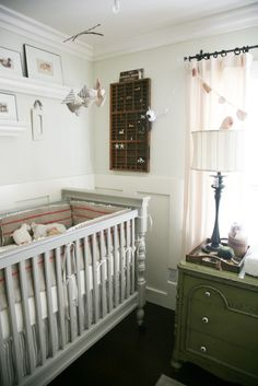 beautiful neutral nursery with gray crib, green dresser and that bedding is awesome!