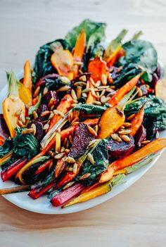 A colorful roasted vegetable salad with creamy garlic dressing and toasted pepitas that highlights the beautiful, jewel-toned fall vegetable harvest. Roasted Vegetable Salad, Roasted Vegetables, Roasted Beet Salad, Carrot Salad, Fall Vegetables, Veggies, Creamy Garlic Dressing, Bette, Vegetarian Recipes