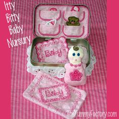 Altoids Tin Baby. Cute but not for a child under 3 because of choking hazard.