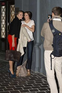 Princess Mary and a friend out to dinner. Mary wore the jacket from Heartmade and under a white, blouse from Rabens Saloner. The new shoes she was wearing are from Prada collection spring 2011. The bag is also Prada.