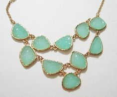 I love this bib necklace, especially the mint-colored stones contrasting with the pretty gold.  I would pair it with a white dress and sandals in the spring.