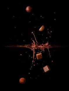 Our luxury artisan chocolates falling through the air.