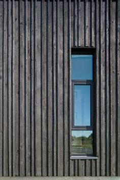Charred wood vertical siding planks provide depth and shadow to the facade, seen here at this window opening detail a Fire Station 76 by Hennebery Eddy Architects. Larch Cladding, House Cladding, Wood Cladding Exterior, Timber Battens, Exterior Stairs, Wall Exterior, Exterior Siding, Wood Architecture, Architecture Details