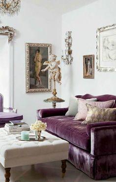 Elegant feminine room with velvet violet sofa