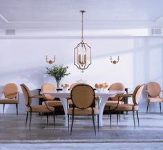Soft, gold touches like this light from are the perfect contrast to this bright, white dining room. Need some help designing the dining room of your dreams? Stop by our showroom today so that one of our consultants can help you!