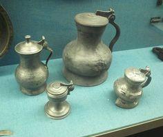 Tin drinking-vessels and jug, medieval. photo tinkander_middelalder.jpg