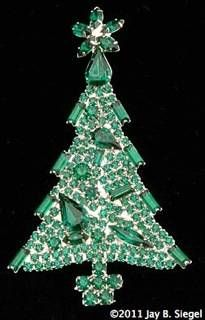 """Dominique Green Christmas TreePin  Ca.Mid-1990s    Collage style Christmas tree pin with green rhinestones. Measures 3 5/8"""" tall."""