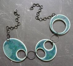 Hand built porcelain necklace on The Rabbit Muse blog, created by artist Nancy E. Schindler.