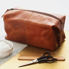 Leather Wash Bag. This leather wash bag combines distressed buffalo leather and a waterproof lining to give beautiful vintage character - ideal for travelling in style!