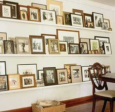 Idea for the wall behind the TV...perfect for shelves filled with frames (photos and things)...