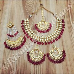Rivaazz Creations makes the most beautiful kundan sets, like this one accented with maroon stones. Jewelry Design Earrings, Pink Jewelry, India Jewelry, Beaded Jewelry, Gold Jewellery, Pakistani Jewelry, Indian Wedding Jewelry, Bridal Jewelry, Stylish Jewelry