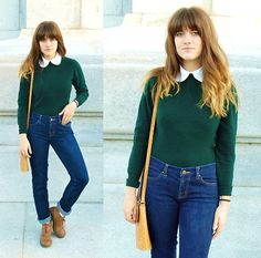 Sweater, button up shirt, and high waisted jeans. I like it.