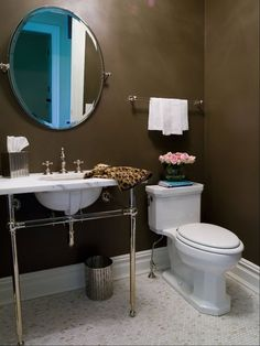 Crystal Metal Round Two Leg Single Washstand, Waterworks Crystal Crystal Single Towel Bar over toilet with Waterworks Engine Turned Pewter Oval Waste Can and matching Waterworks Engine Turned Pewter Square Tissue Cover