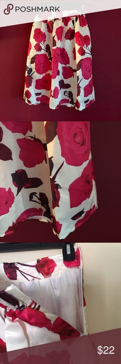 """Red & Pink Flower Print Pleated Skirt Retro style midi skirt has a big bold red and pink flowered design. Zips up the side with an elastic waist. Fully lined in white satin. Measures 23""""inches long and 12""""inches across the top. Skirts Midi"""