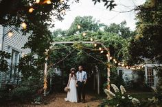 Behind the home, there are string lights and wisteria which add to the ambiance.