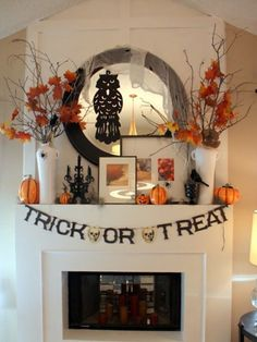 If you don't want your mantel to be both Halloween- *and* fall-themed, combine both concepts with crows and spiders, punctuated by fall leaves and and gourds.