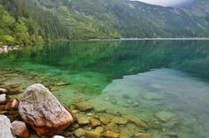 """Crystal clear, turquoise waters of Morskie Oko - """"The eye of the sea"""" lake in Tatra Mountains, Poland http://www.adventurous-travels.com/2014/05/morskie-oko-and-czarny-staw-lakes-tatra.html"""