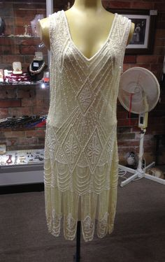 1920s Style Flapper Dress Cream with white/cream beading The look of the dress can be changed with different coloured slips (Not included