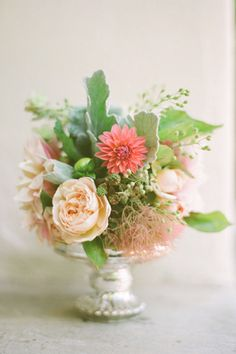Soft arrangement of roses, dahlias, smoke bush, dusty miller. Southern Weddings Magazine