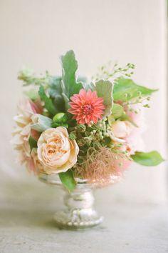 Soft arrangement of roses, dahlias, smoke bush, dusty miller. Southern Weddings Magazine