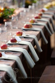 Fall-themed table setting with apples and mason jars