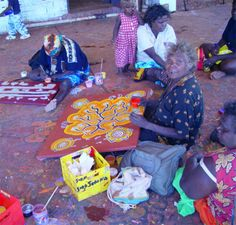 women sitting, painting, singing together 2. www.personally-selected-aboriginal-art.com