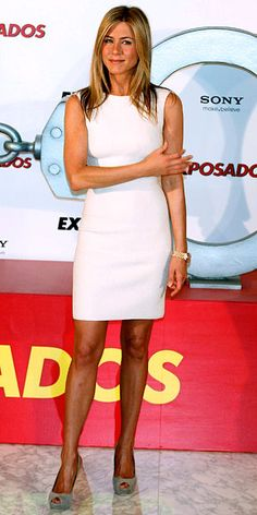 Jennifer Aniston    WHAT SHE WORE    Aniston paired a sophisticated white shift dress with gray peep-toe Gucci pumps while promoting The Bounty Hunter in Madrid.