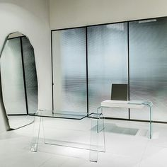 """GLAS ITALIA 2017 COLLECTION slideshow / 5 """"FOLIO"""" elegant desk in extralight curved glass """"STRATA"""" vanity/desk in curved and lacquered glass Both designed by Yabu Pushelberg ................ #glasitalia #sdm2017 #salonedelmobile2017 @yabupushelberg #yabupushelberg www.glasitalia.com"""
