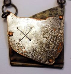 Repurposed silver plated alloy metals with heat treated patina.