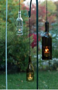 """wine bottle lanterns - love this DIY Kendall We should make some of these.I have a bunch of empty wine bottles and I am sure you can """"come up"""" with some! Diy Bottle, Wine Bottle Crafts, Bottle Art, Bottle Garden, Wine Bottle Lanterns, Bottle Lights, Bottle Candles, Bottles And Jars, Glass Bottles"""