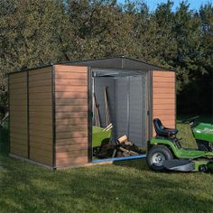 The Woodvale Metal Shed from Rowlinson is designed to resemble a wooden shiplap shed. The coffee coloured wood grain effect will look perfect in any setting. The low maintenance shed is fire, and rot resistant. The shed features double sliding doors to the front which are fully lockable.