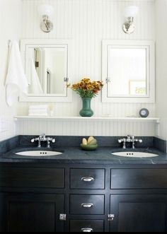Double vanity with rectangular mirrors and centerpiece