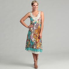 @Overstock - A bold abstract print covers this silk dress by Ebene with unique style. Feminine updates like a bejeweled V-neck collar and double eyelet ruffles at the hemline finish this sleeveless dress.http://www.overstock.com/Clothing-Shoes/Ebene-Womens-Turquoise-Abstract-Silk-Sleeveless-Dress/6813597/product.html?CID=214117 $38.99