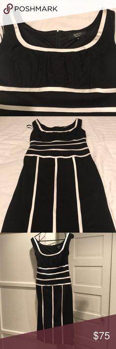 Tadashi dress size medium Black dress with white stripe, stretch fabric with longer length. Super comfortable dress worn one time. Tadashi Shoji Dresses