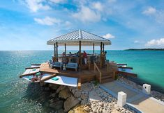 Latitudes over-the-water bar allows for sweeping views of the sea | Sandals Resorts | Jamaica