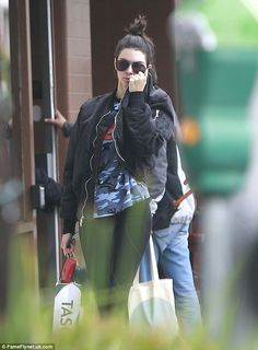 Incognito: Kendall Jenner, 21, was the epitome of cool in black leggings and a black bomber jacket while picking up a few items in Beverly Hills on Friday