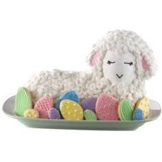 A beautiful addition for your Easter dinner table, this lamb cake is covered in buttercream icing rosettes and surrounded by colorful Easter egg cookies. The combination of cake and cookies makes a great presentation when extra servings are desired. Easter Cupcakes, Easter Cookies, Easter Treats, Easter Lamb, Easter Eggs, Easter Food, Easter Hunt, Wilton Cake Decorating, Cookie Decorating