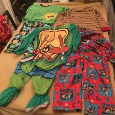 3t boys pajamas 4pairs 1. Ninja turtles pajamas footies 2.Thomas the train 3.short sleeve sleepy monster 4. Brown striped thermal pajamas all are 3t. Buy in bundle and save on shipping. Intimates & Sleepwear Pajamas