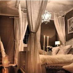 lovely white canopy bed.